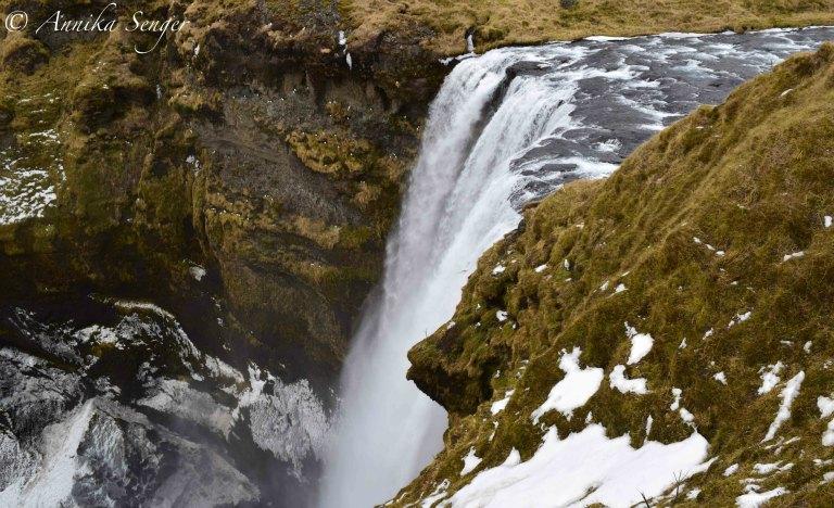 island im Winter Wasserfall Skogarfoss